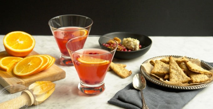 Amaretto cranberry shrub cocktail + Herbs black pepper crackers