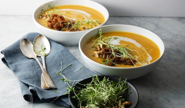 Roasted garlic and butternut soup with apple chutney and crunchy toppings (vegan)