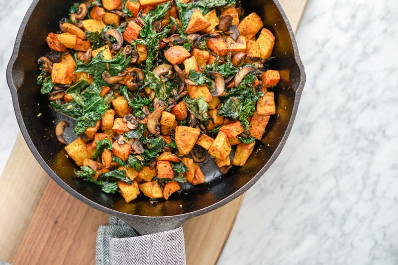 aerial view of Potato, Mushroom and Kale Hash in cast-iron skillet
