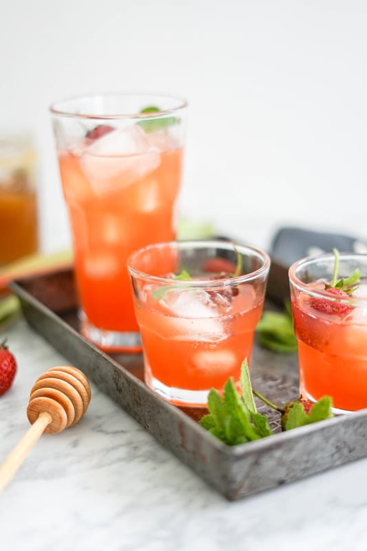 3 glasses of strawberry rhubarb lemonade in an old metal tray