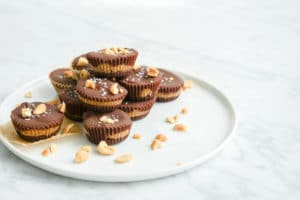 horizontal eye-level view of a white plate piled with peanut butter cups