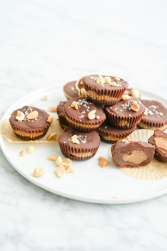 close-up view of homemade peanut butter cups, with one cut in half to see the inside
