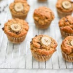 horizontal view of several muffins on a cooling rack