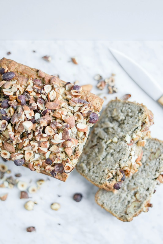 top down view of gluten-free banana bread with chopped nuts on top