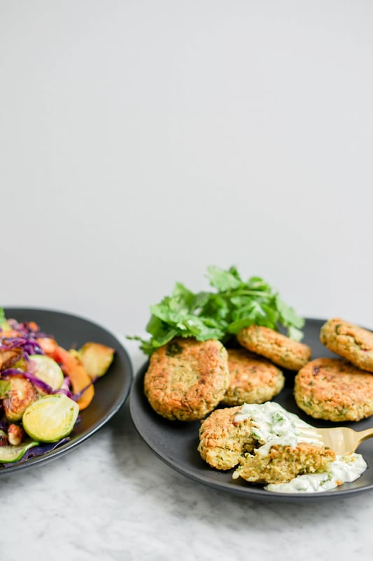 front view chickpea fritters and warm vegetable salad