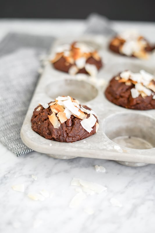 Close-up front view of a double chocolate muffin in a muffin tin